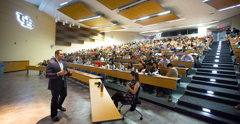 Students in a large lecture hall